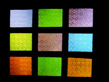 This is multicolored stained glass on black background. This is multicolored stained glass on  black background Stock Photos