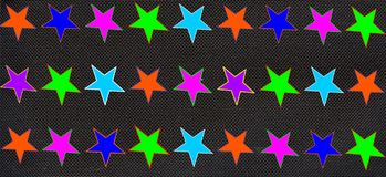 Multicolored stars black background Stock Photos