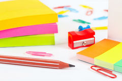Multicolored stationery supplies on white desktop closeup Stock Photos