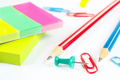 Multicolored stationery on white desktop close up Royalty Free Stock Image
