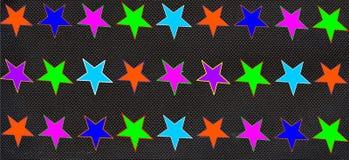 Multicolored sterren zwarte achtergrond Stock Foto's