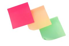 Multicolored stickers. Three multi colored stickers hanging on the wall Stock Photo