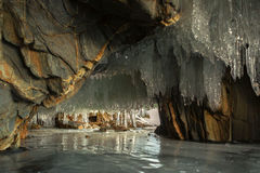 Multicolored stone grotto with icicles. Royalty Free Stock Photos