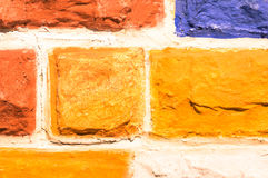 Multicolored stone wall background - Hand painted construction Stock Photos