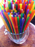 Multicolored straws. In the bucket royalty free stock images