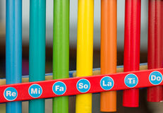 Multicolored strips of  xylophone with notes. Royalty Free Stock Image