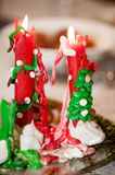 Multicolored stucco homemade candles from red green and white wax royalty free stock photos