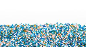 Multicolored Sugar sprinkle dots, decoration for cake. copy space. Multicolored Sugar sprinkle dots, decoration for cake, isolated on white. Birthday and holiday stock photo