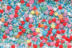 Multicolored Sugar sprinkle dots, decoration for cake. Background image, texture. Flat lay, top view royalty free stock photography