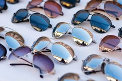 Multicolored sunglasses with many formes stock photo