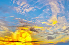 Multicolored sunrise with golden football ball Stock Images