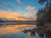 Multicolored sunset on the lake in early spring Royalty Free Stock Photography
