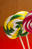 Multicolored sweet candy canes and twirls on wooden sticks. Variety Stock Photo
