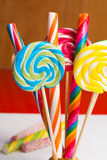 Multicolored sweet candy canes and twirls on wooden sticks. Variety Stock Image