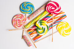 Multicolored sweet candy canes and twirls on wooden sticks. Variety Royalty Free Stock Image
