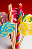 Multicolored sweet candy canes and twirls on wooden sticks. Variety Royalty Free Stock Photos