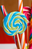 Multicolored sweet candy canes and twirls on wooden sticks. Variety Stock Photos