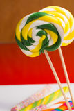 Multicolored sweet candy canes and twirls on wooden sticks. Variety Royalty Free Stock Photography