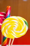 Multicolored sweet candy canes and twirls on wooden sticks. Variety Stock Images