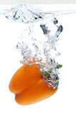Multicolored Sweet pepper Splash. Sweet pepper dropped in tank. Shot on white Royalty Free Stock Images
