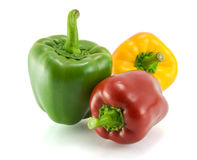 Multicolored sweet pepper on a white background Royalty Free Stock Photos