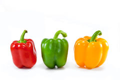 Multicolored sweet peppers isolated on white Royalty Free Stock Image