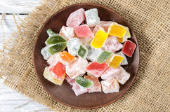Multicolored sweets in a clay plate. Top view Royalty Free Stock Image
