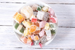 Multicolored sweets in a white plate. Sweets Stock Image