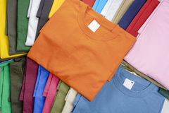 Multicolored t-shirts. Collection of casual T-shirts in different colors filling the frame royalty free stock photo