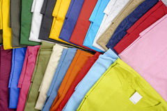 Multicolored t-shirts. Collection of casual T-shirts in different colors filling the frame royalty free stock photography