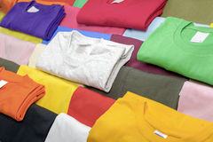 Multicolored t-shirts. Collection of casual T-shirts in different colors. Filling the frame royalty free stock photo