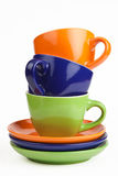 Multicolored teacups and saucers Stock Image