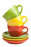 Multicolored teacups and saucers Royalty Free Stock Image