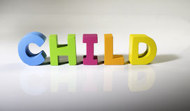 Multicolored text child made of wood. Royalty Free Stock Photography