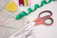 Multicolored thread coils and measuring tape on white background. stock photos