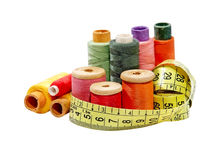 Multicolored thread spools and measurement tape.Isolated. Royalty Free Stock Image