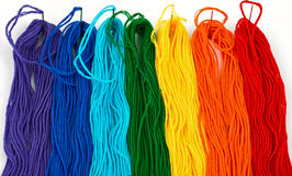 Multicolored threads. A rainbow of colorful threads Stock Photo