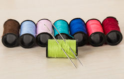 Multicolored threads and needles Stock Images