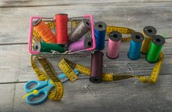 Multicolored threads, scissors and ruler. stock image