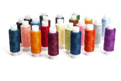Multicolored threads for sewing on spools Stock Photos