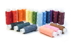 Multicolored threads for sewing on spools Stock Image