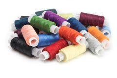 Multicolored threads for sewing on spools Royalty Free Stock Images