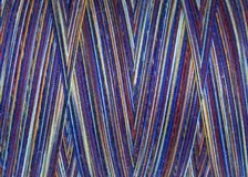 Multicolored threads in spool,macro Stock Photography