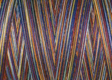 Multicolored threads in spool,macro Royalty Free Stock Photography