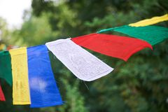 Tibetan flags closeup. Multicolored tibetan flags in the park closeup Stock Photos