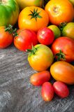 Multicolored Tomatoes On Wooden Background Stock Photography