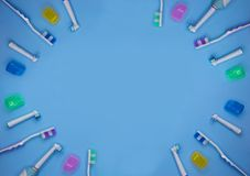 Multicolored toothbrushes on a blue background with copy space royalty free stock photography