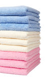 Multicolored towels stacked Stock Images