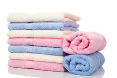 Multicolored towels stacked Stock Photo