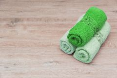 Multicolored towels on a wooden background stock image